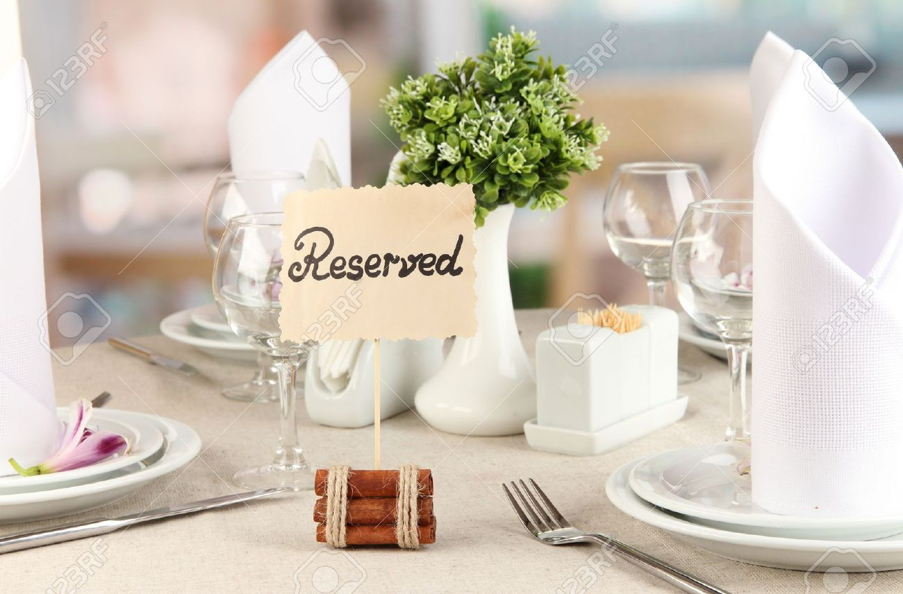 Reserved Sign On Restaurant Table With Empty Dishes And Glasses - Restaurant table signs