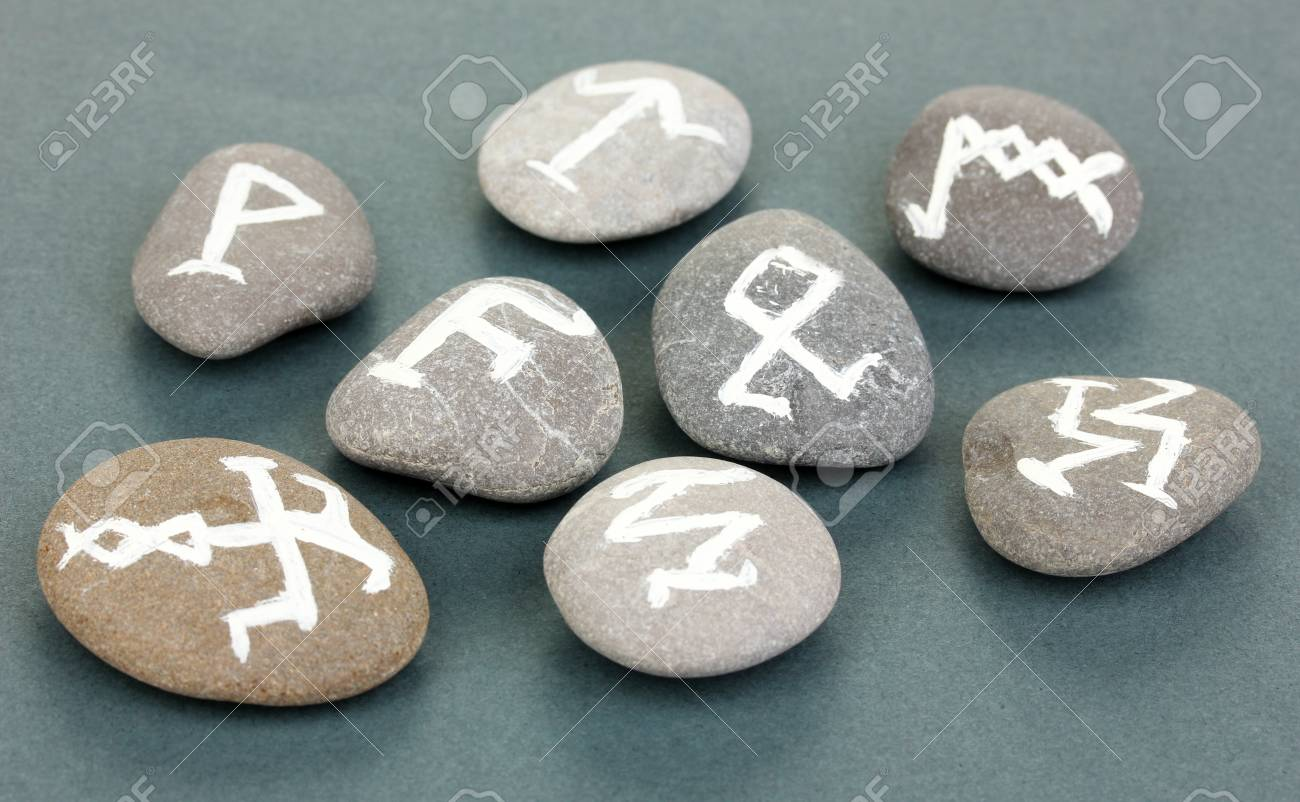 Fortune telling  with symbols on stones on grey background Stock Photo - 19100894