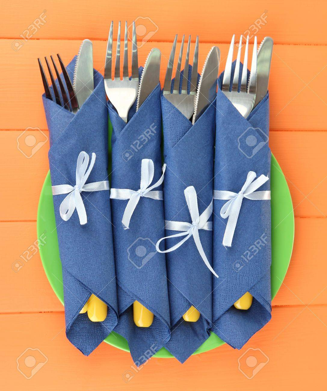 Forks And Knives Wrapped In Blue Paper Napkins On Color Wooden Stock Photo Picture And Royalty Free Image Image 19174589