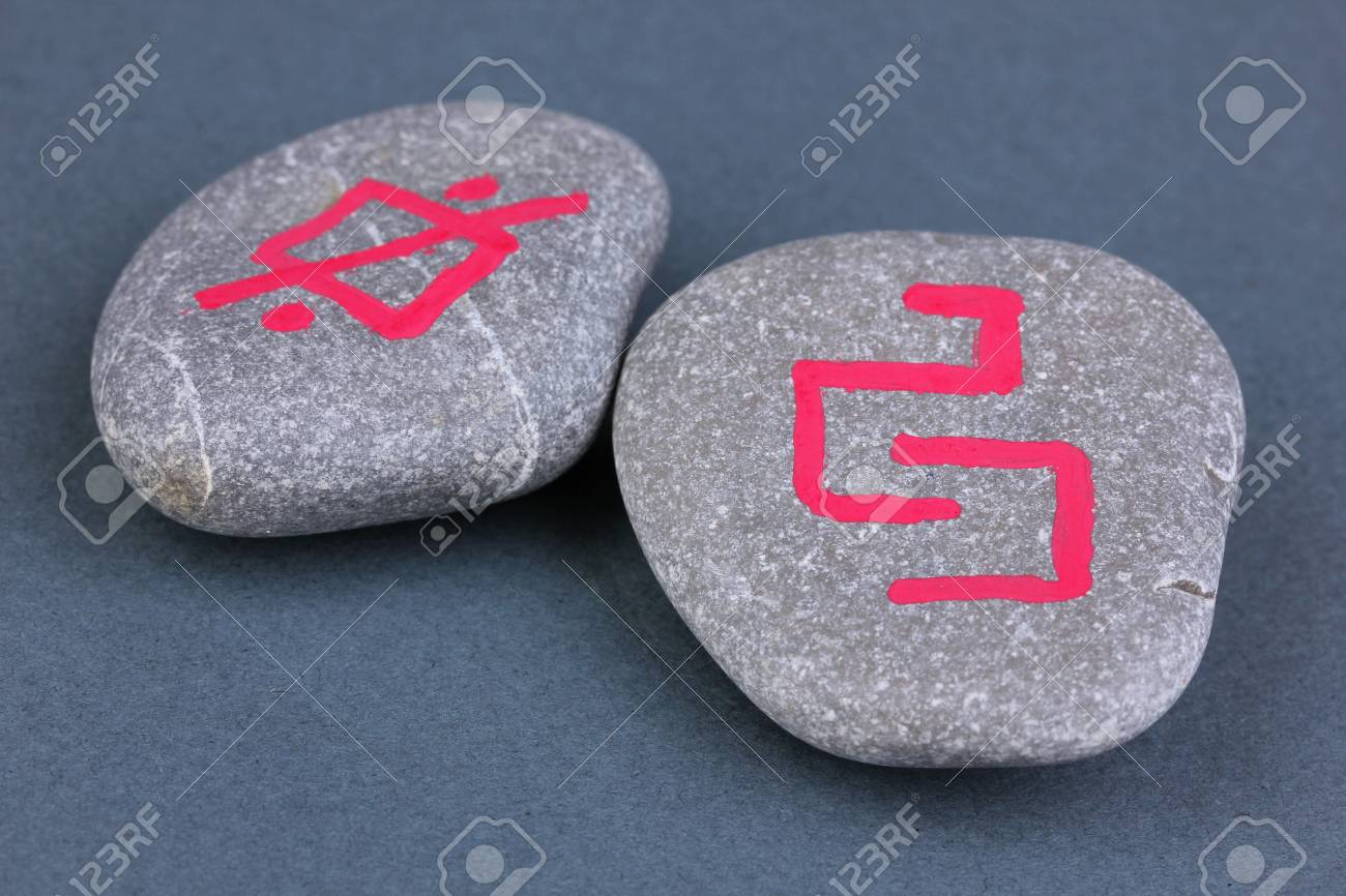 Fortune telling  with symbols on stones on grey background Stock Photo - 19271619