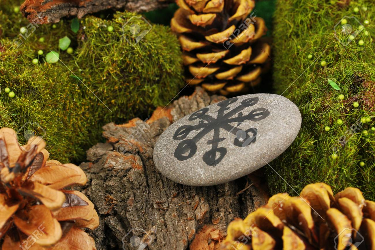 Fortune telling  with symbols on stone close up Stock Photo - 19271630