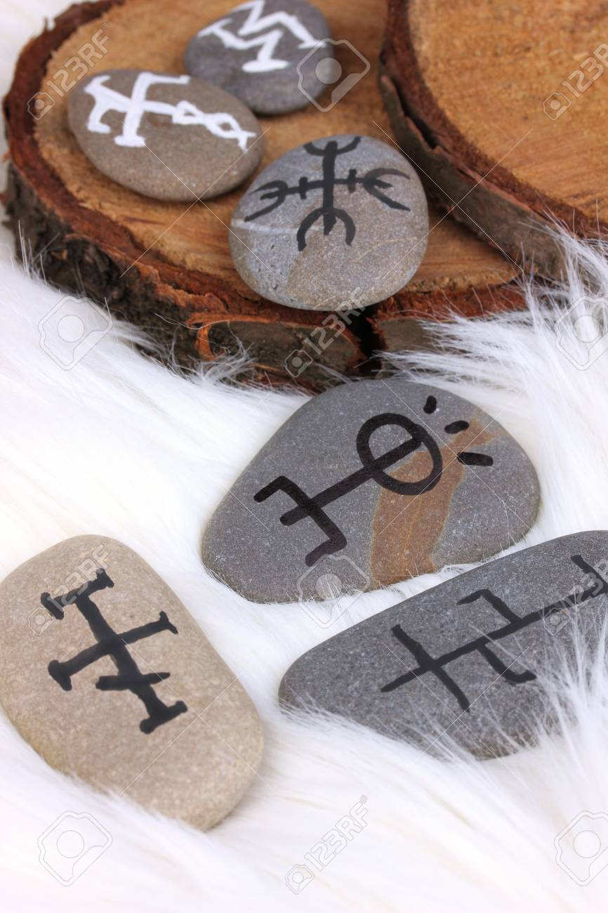 Fortune telling  with symbols on stones on white fur background Stock Photo - 19271556