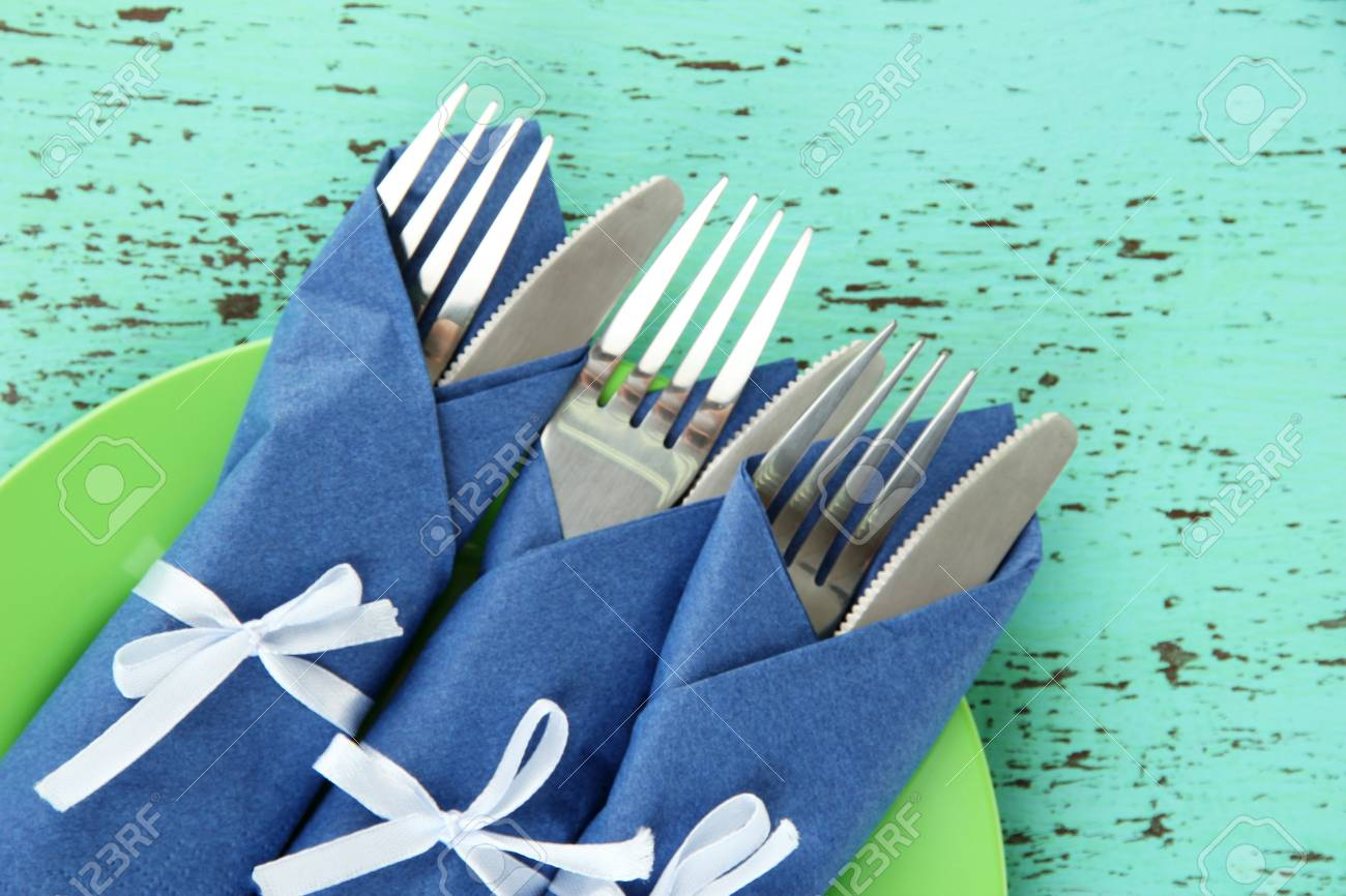Forks And Knives Wrapped In Blue Paper Napkins On Color Wooden Stock Photo Picture And Royalty Free Image Image 19349593