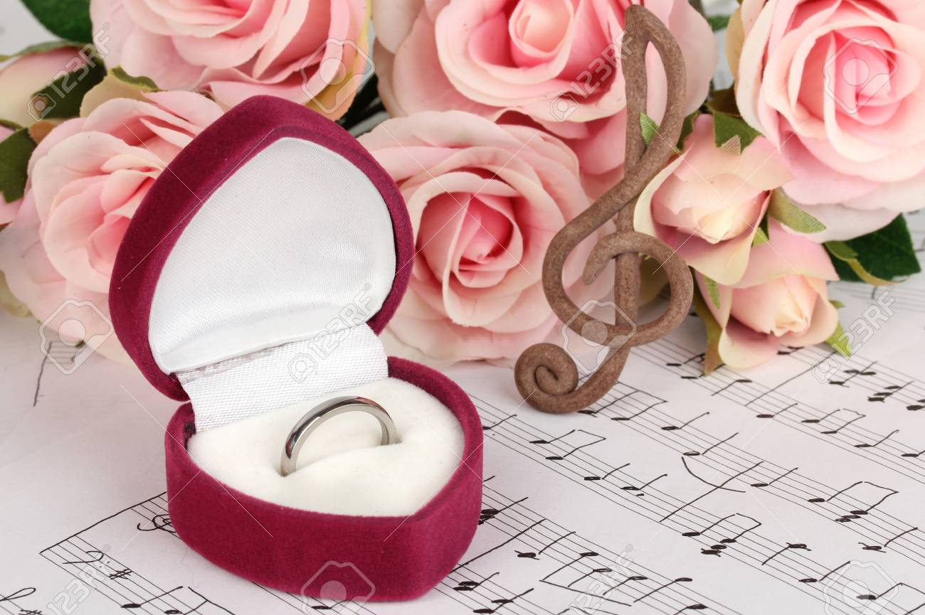 Treble Clef, Roses And Box Holding Wedding Ring On Musical ...
