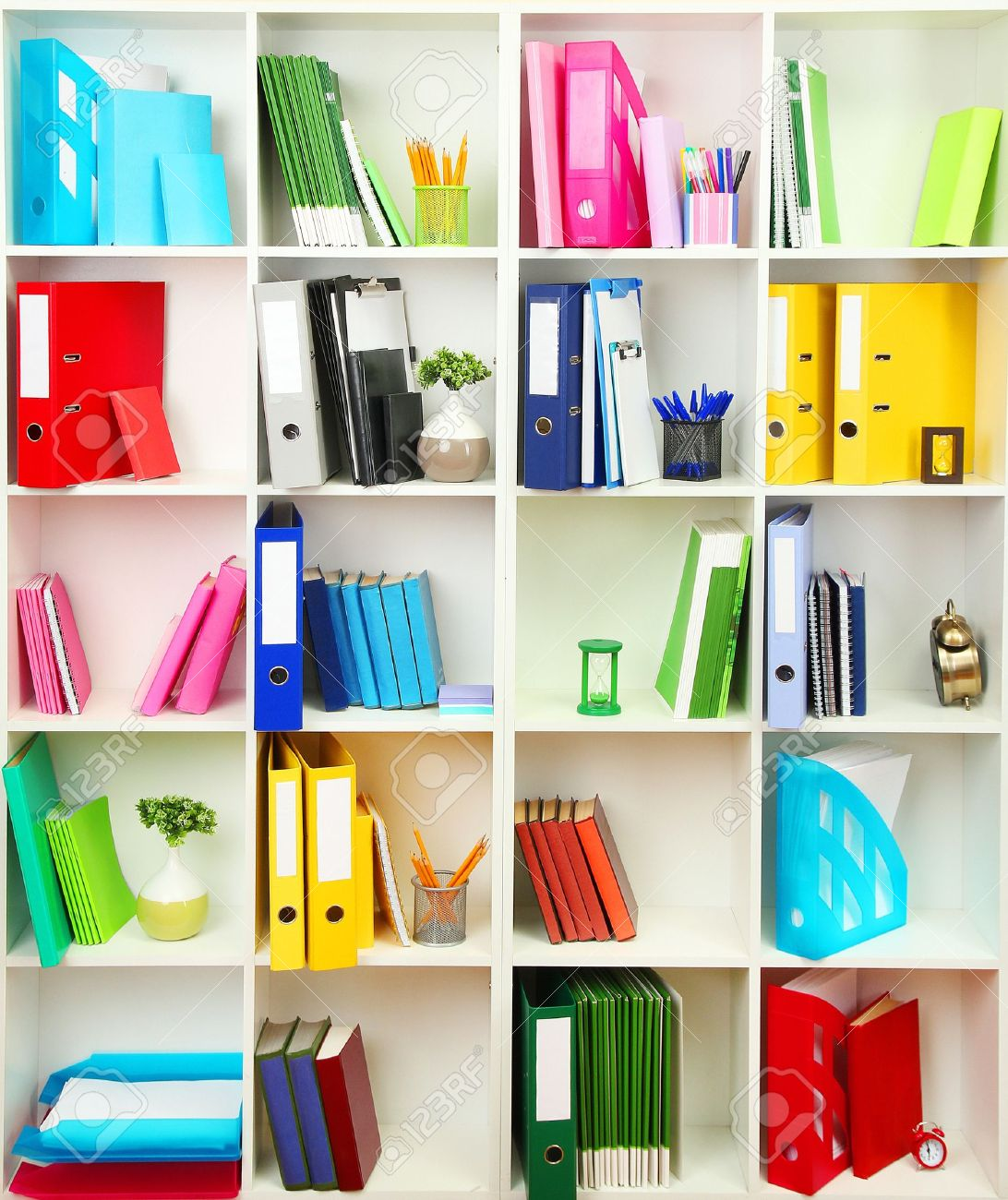 White Office Shelves With Different Stationery, Close Up Stock Photo    19412729
