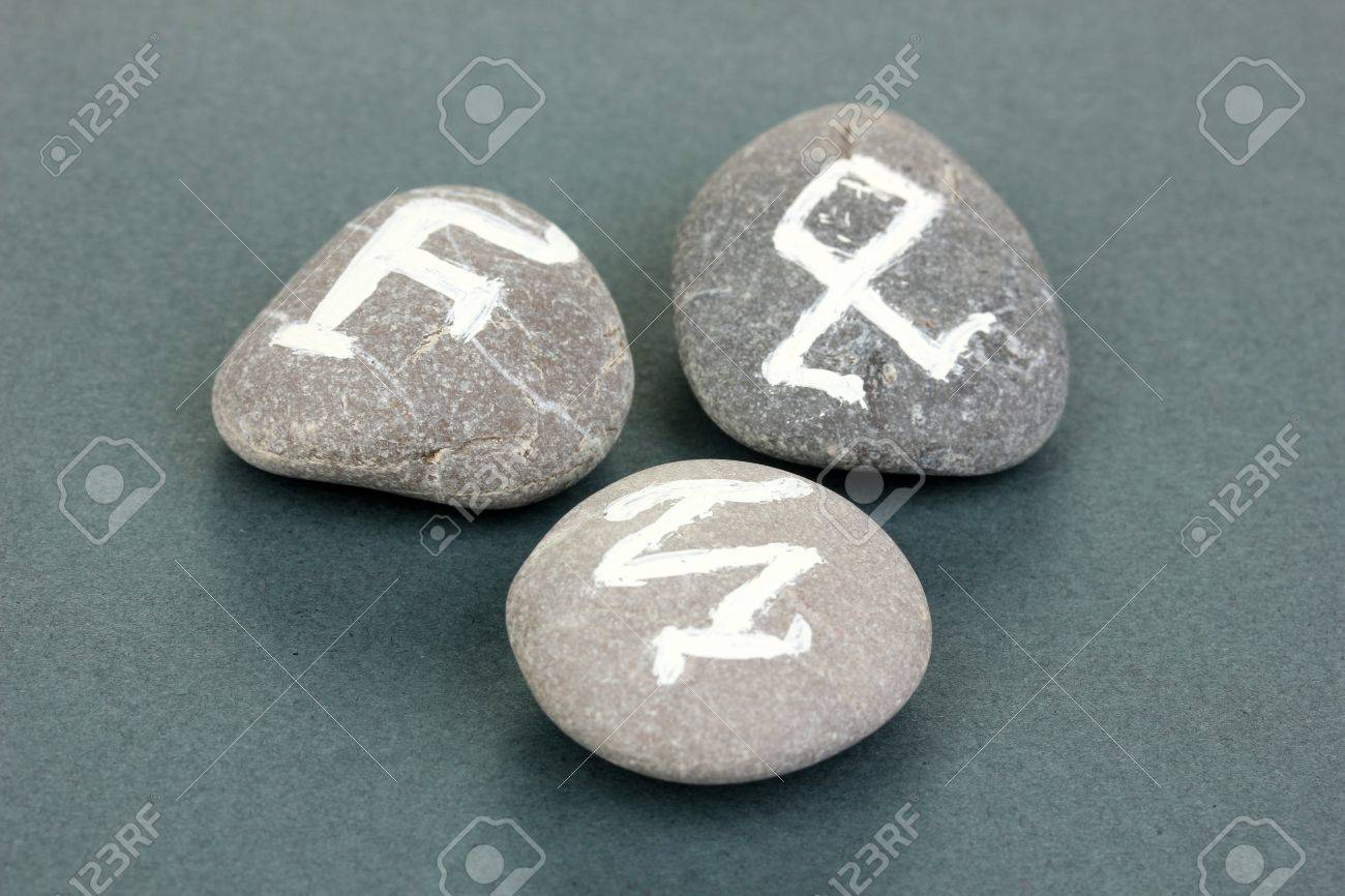 Fortune telling  with symbols on stones on grey background Stock Photo - 19410409