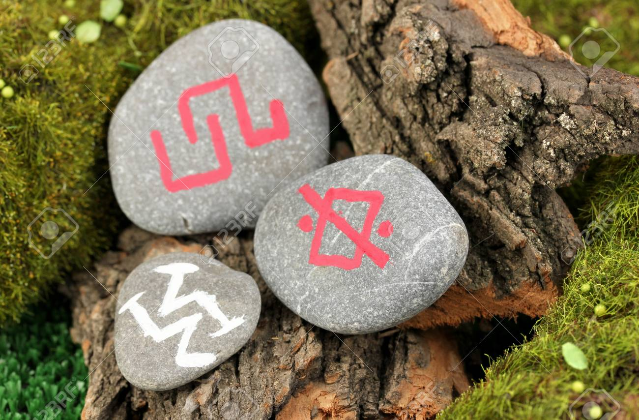 Fortune telling  with symbols on stone close up Stock Photo - 19412847