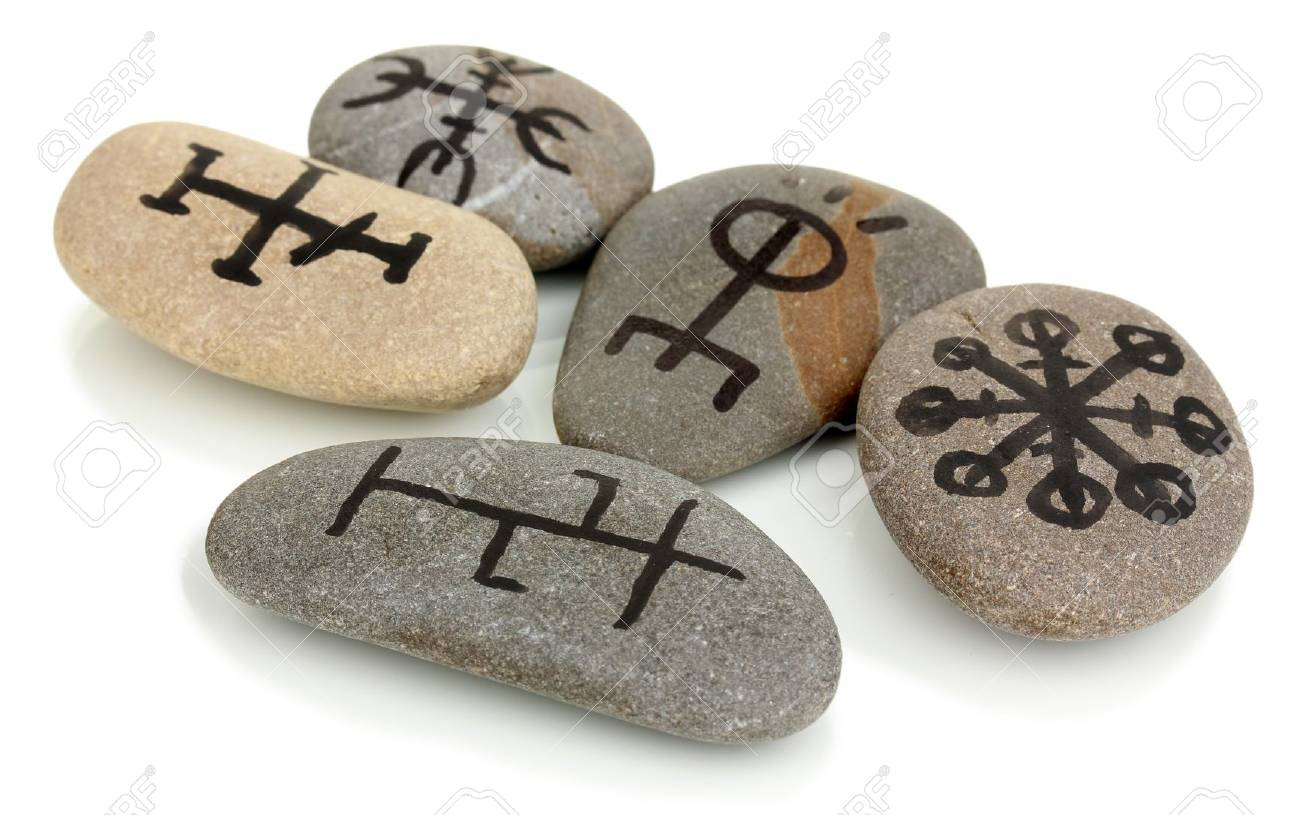 Fortune telling  with symbols on stones isolated on white Stock Photo - 19412258