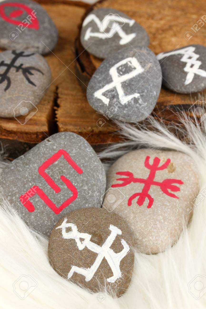 Fortune telling  with symbols on stones on white fur background Stock Photo - 19654748