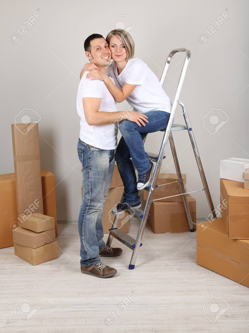 Young couple moving in new house Stock Photo - 21522868