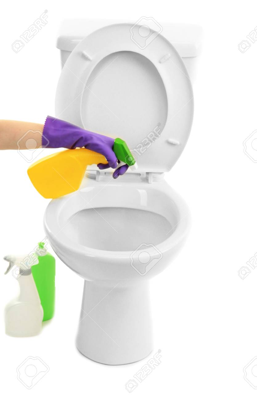Woman hand with spray bottle cleaning a toilet bowl, isolated on white Stock Photo - 19769481