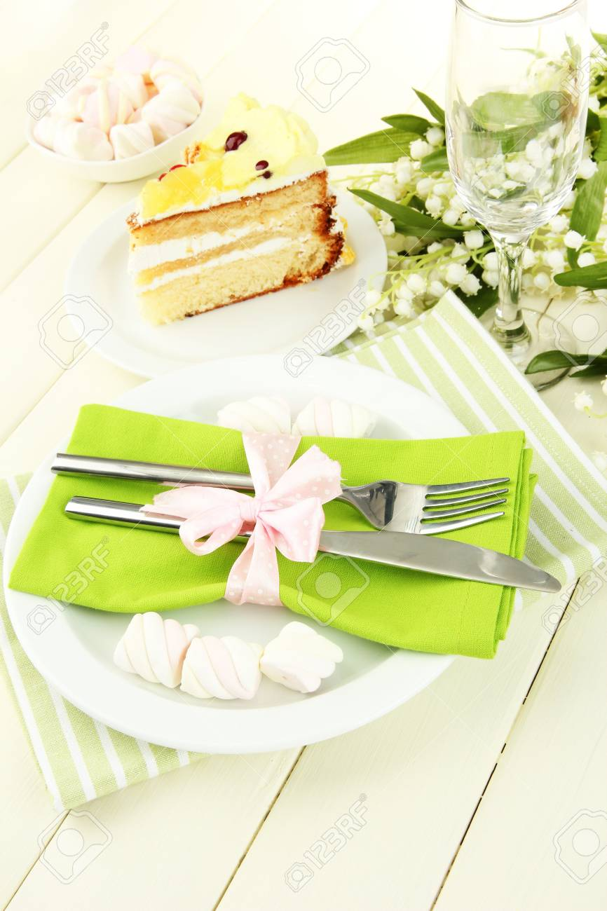 Table setting in white and green tones on color  wooden background Stock Photo - 19974090