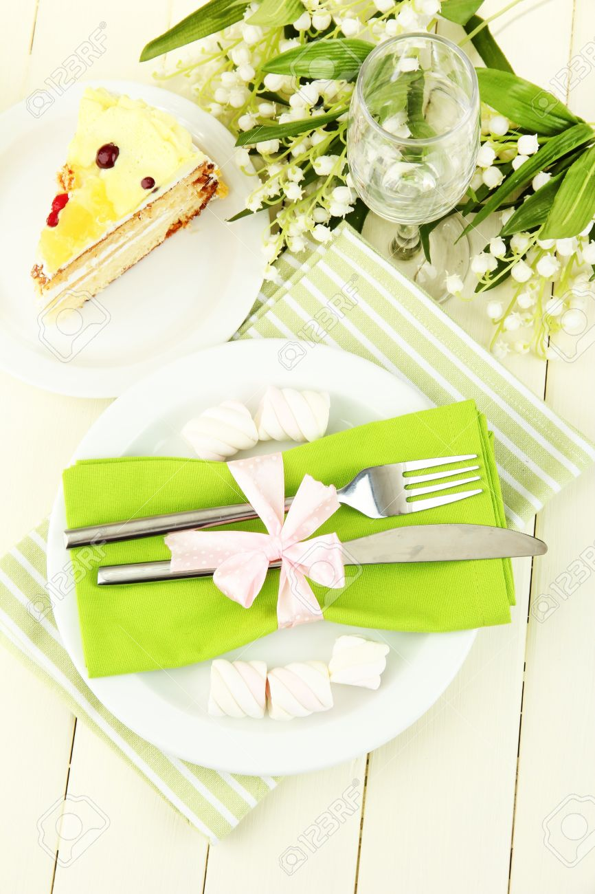 Table Setting Background table setting in white and green tones on color wooden background