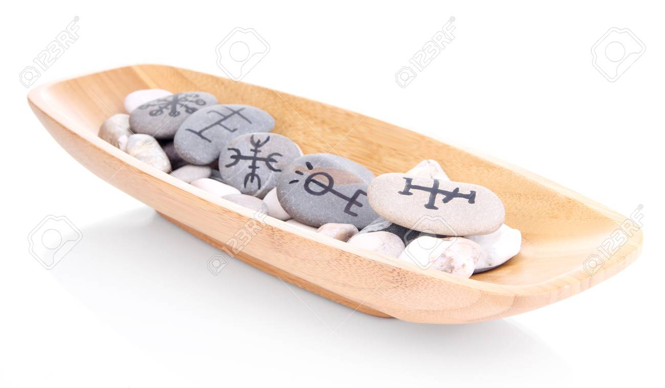 Fortune telling  with symbols on stones in wooden bowl isolated on white Stock Photo - 20124072