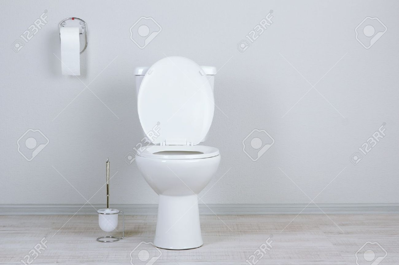 White Toilet Bowl In A Bathroom Stock Photo Picture And Royalty