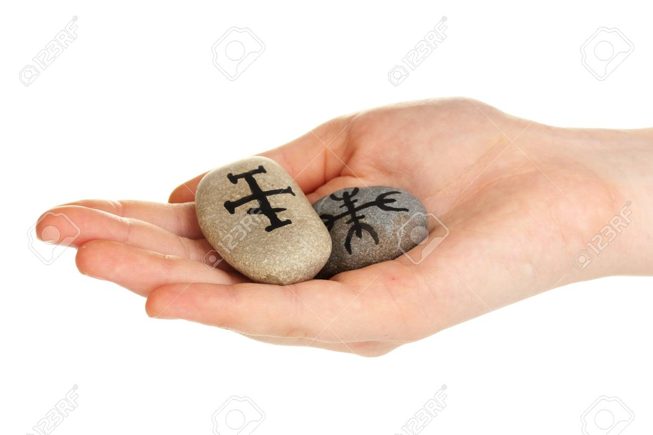 Fortune telling  with symbols on stone in hand isolated on white Stock Photo - 20251167