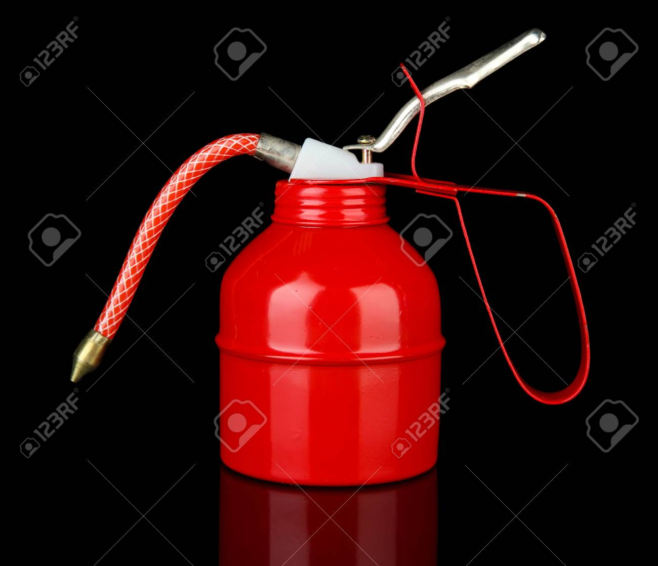 Red oil can, isolated on black Stock Photo - 21108542