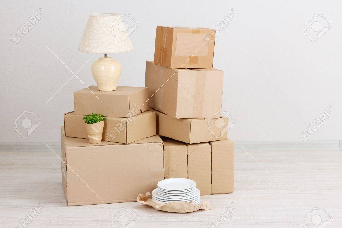 Moving Boxes On The Floor In Empty Room Stock Photo Picture And