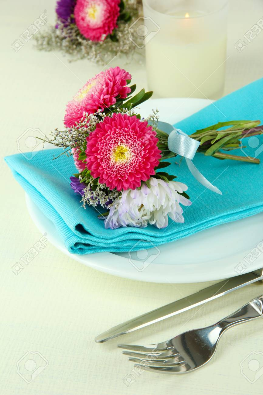 Festive dining table setting with flowers isolated on white Stock Photo - 21473117