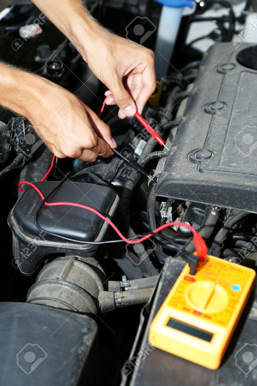 Auto Mechanic Uses Multimeter Voltmeter To Check Voltage Level Car Wiring In Battery Stock Photo 21622805