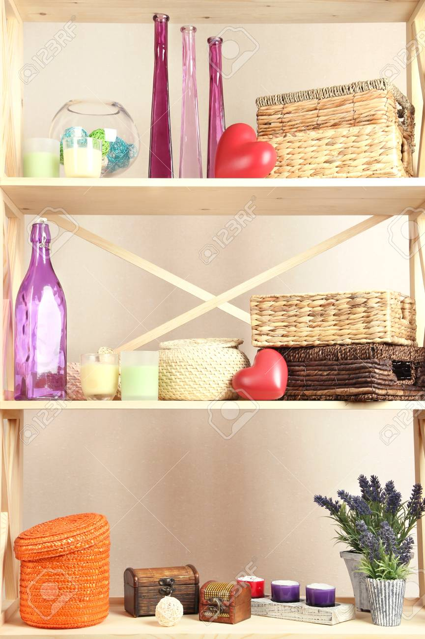 Beautiful white shelves with different home related objects, on color wall background Stock Photo - 21807596