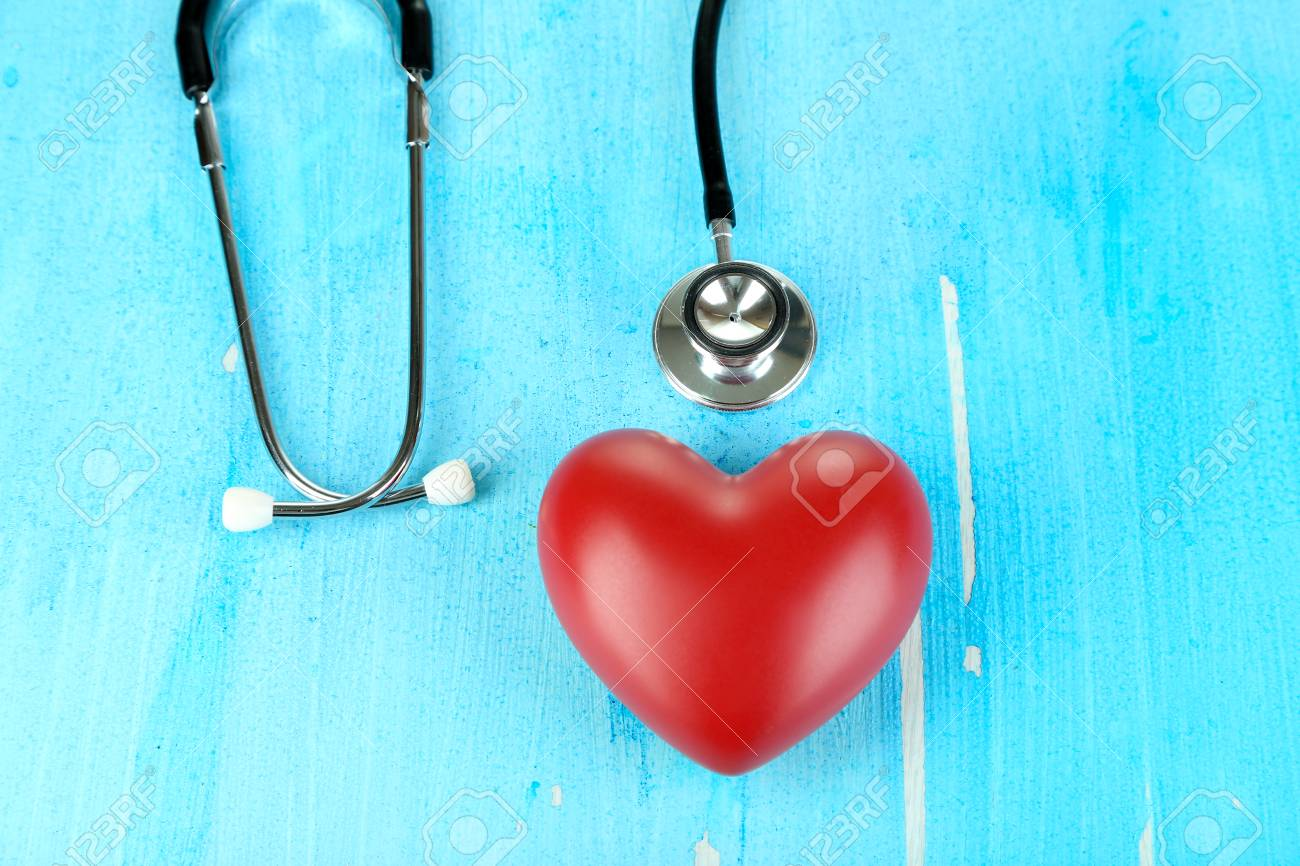 Stethoscope and heart on wooden table close-up Stock Photo - 22353374