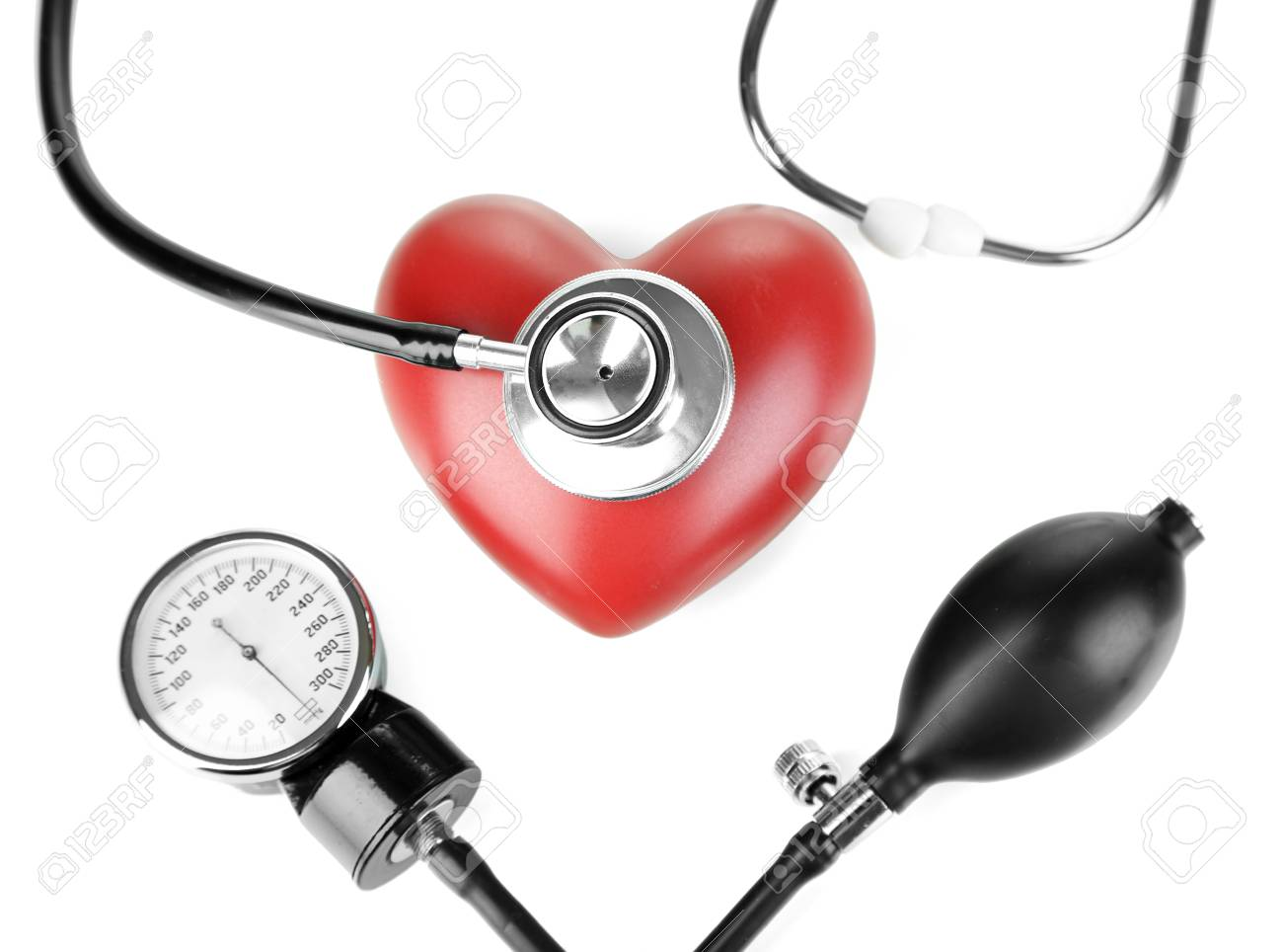 Tonometer, stethoscope and heart isolated on white Stock Photo - 23716407