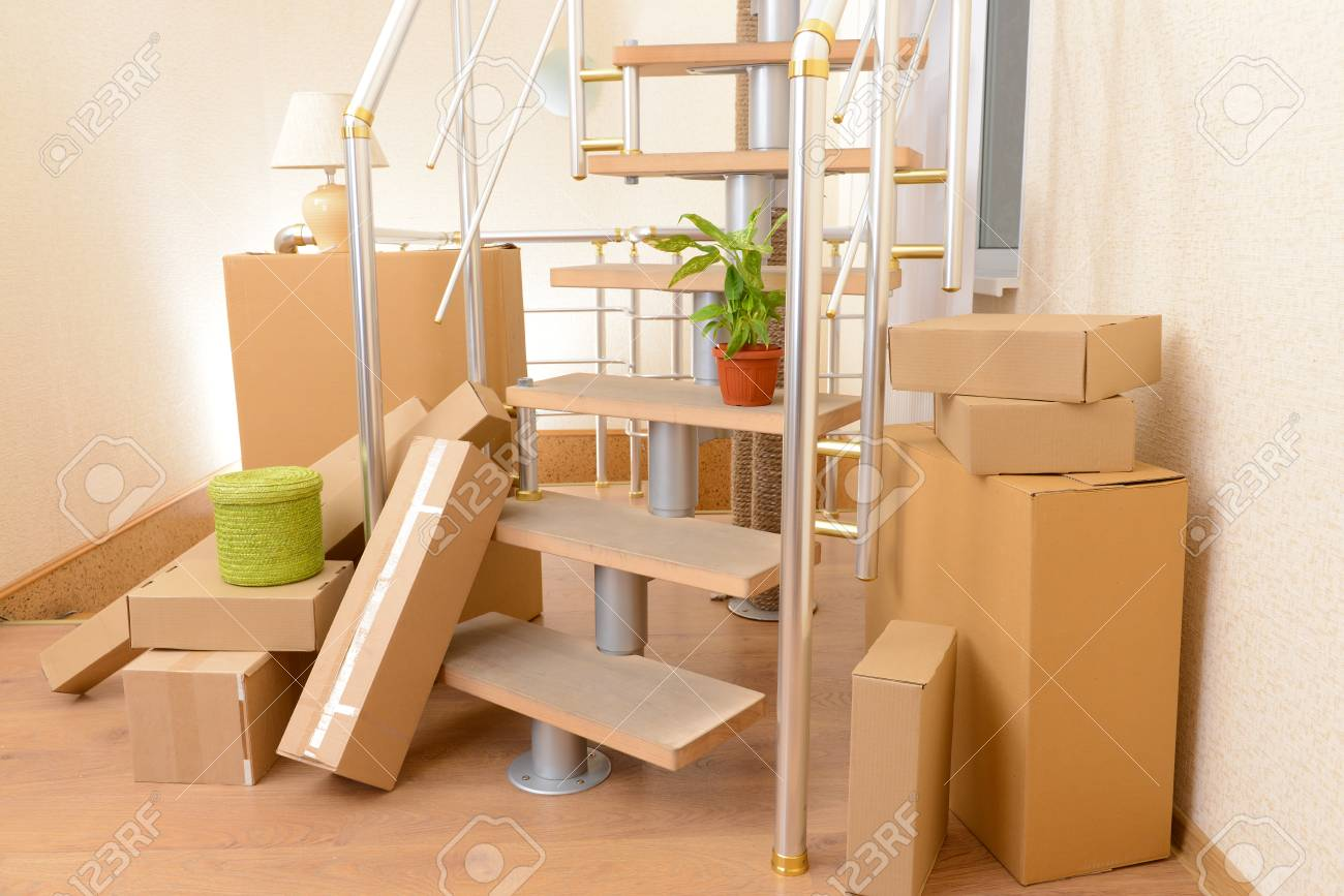 Stack Of Cartons Near Stairs Moving House Concept Stock Photo