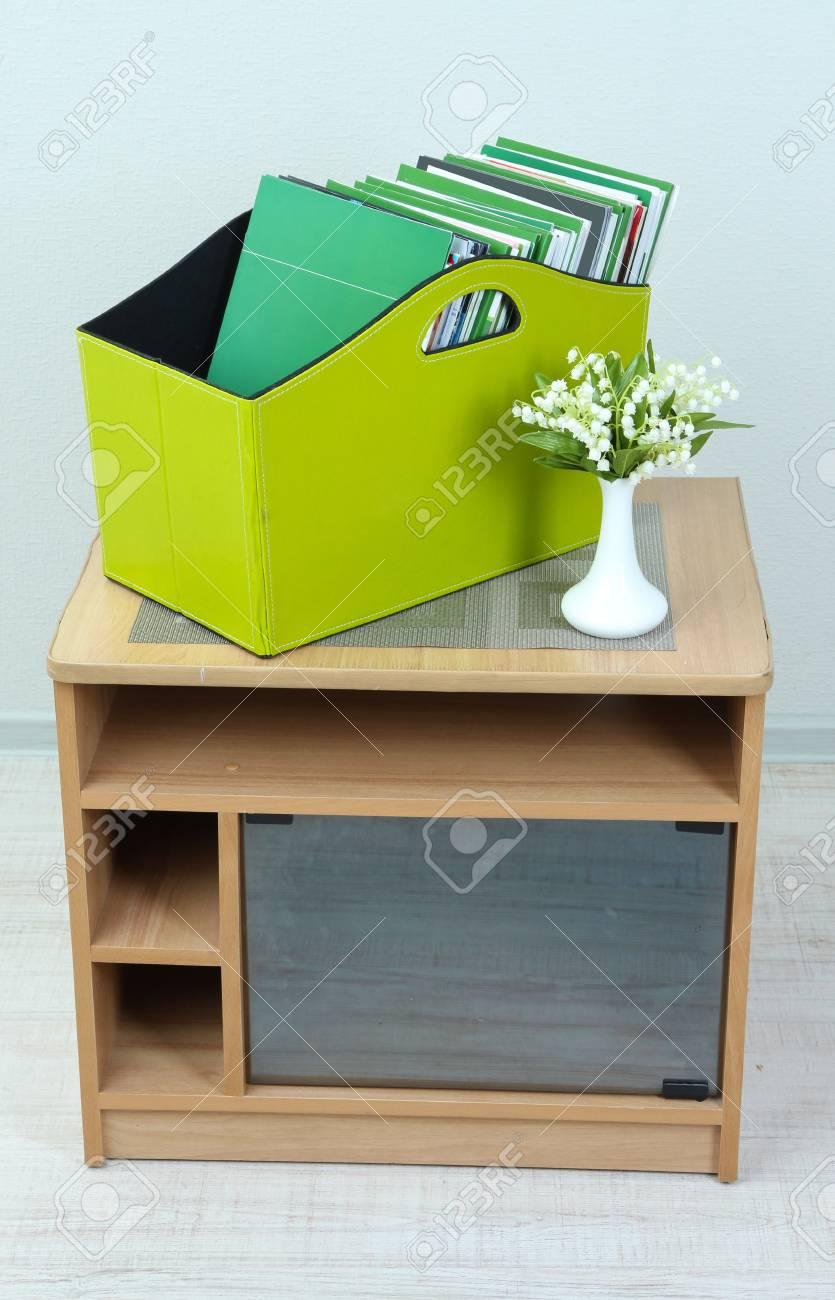 Magazines and folders in green box on bedside table in room Stock Photo - 24104765