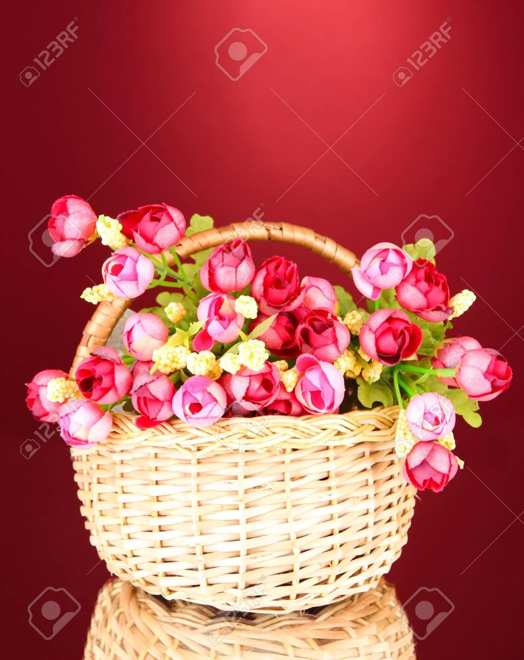 Bouquet Of Beautiful Artificial Flowers In Wicker Basket On Stock