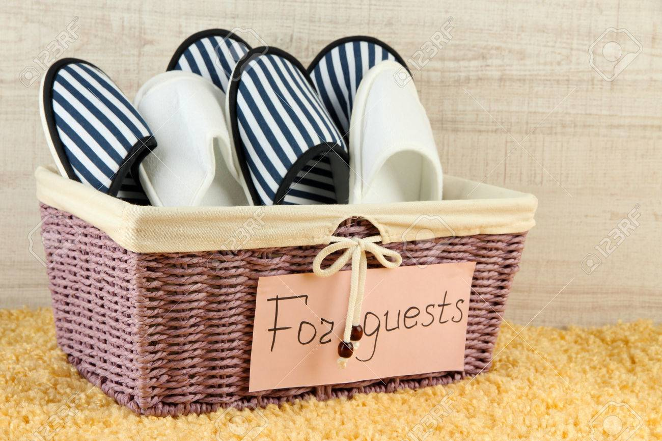 Slippers in basket on carpet on wooden background Stock Photo - 24446091 0e1eb98d8