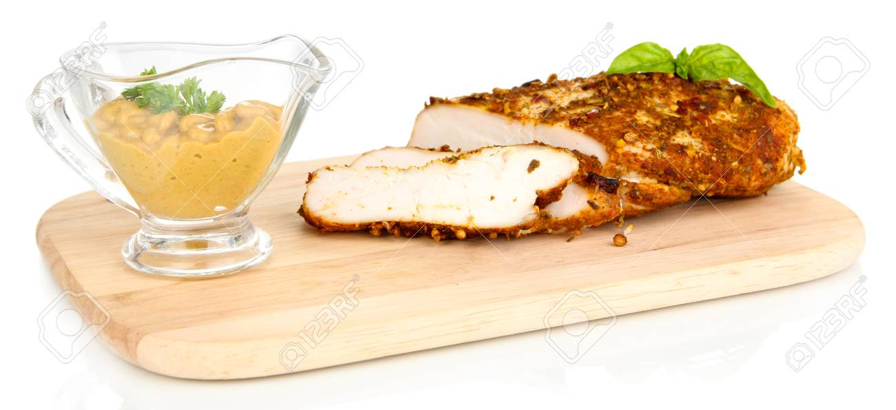 Roasted chicken fillets on wooden board, isolated on white Stock Photo - 24526824