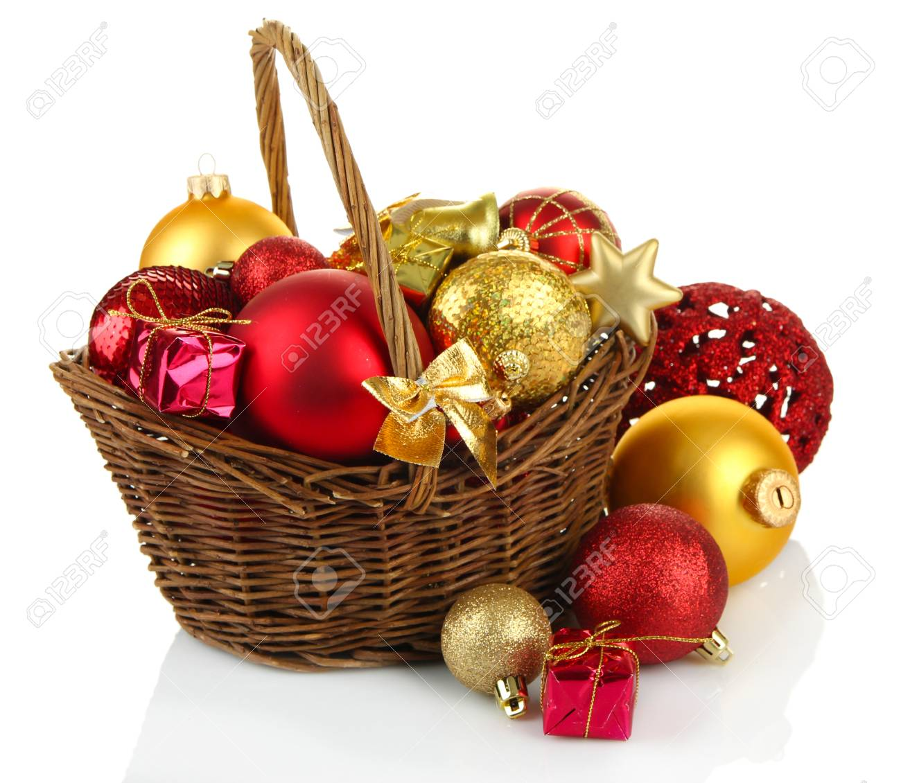 christmas decorations in basket isolated on white stock photo 24528377