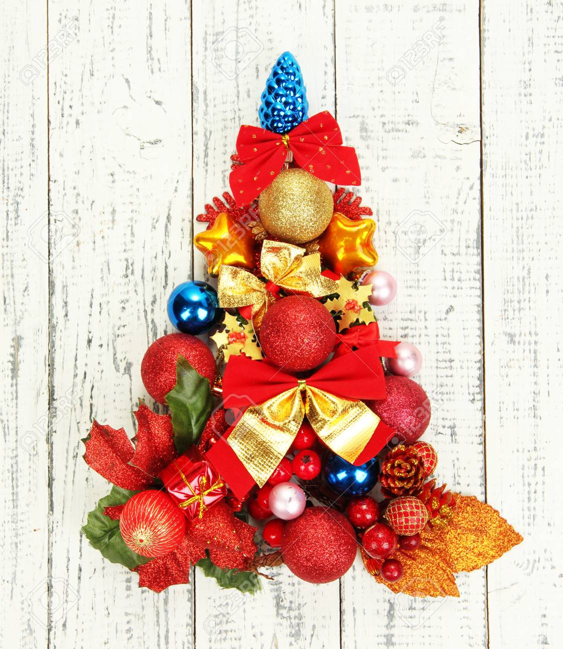 christmas tree of christmas toys on wooden table close up stock photo 24846827 - Sign Up For Free Christmas Toys