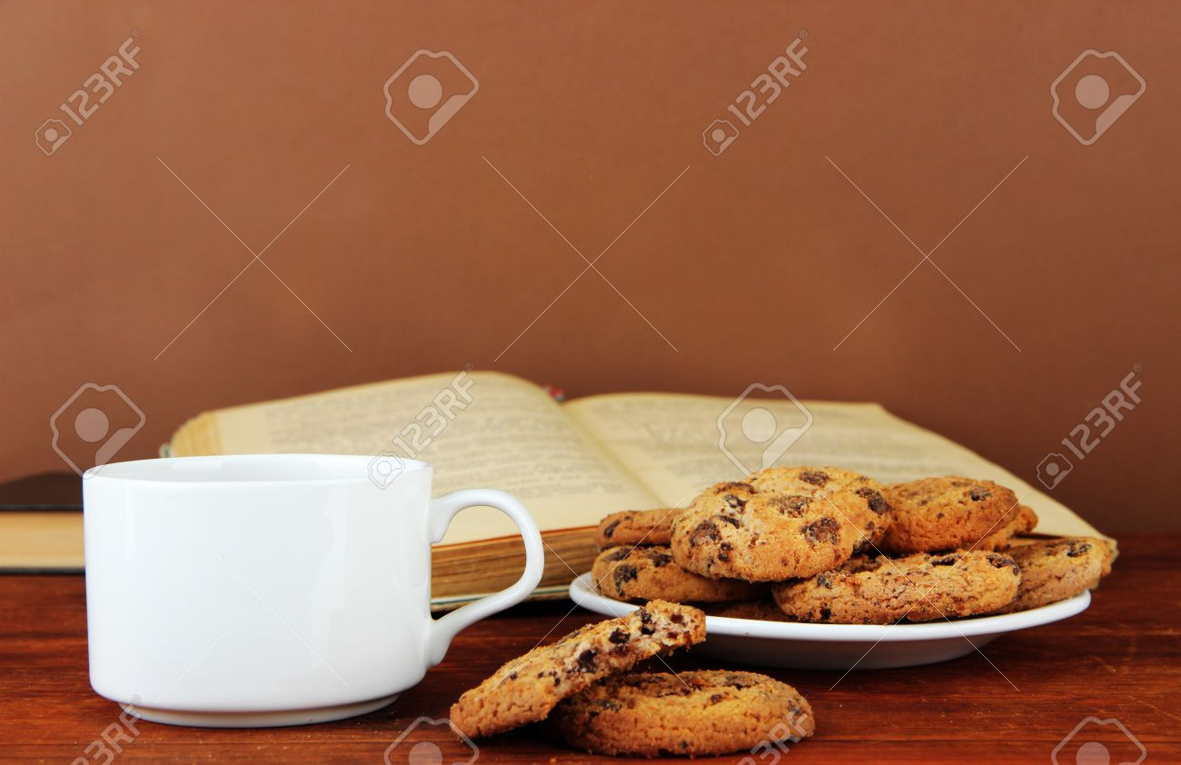 Cookie Coffee Cups Cup Of Coffee With Cookies And Books On Wooden Table On Brown