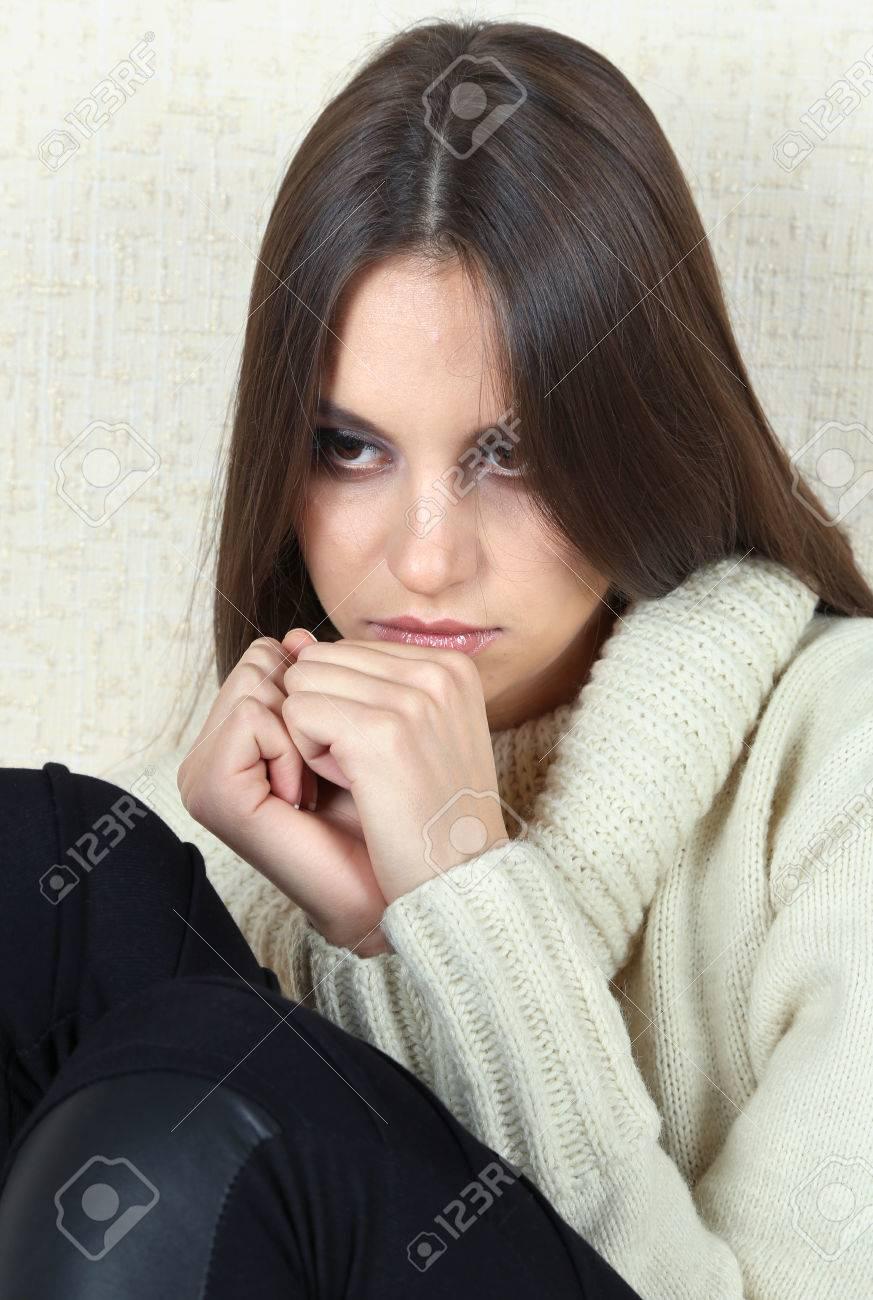 Lonely sad woman near wall Stock Photo - 26397767
