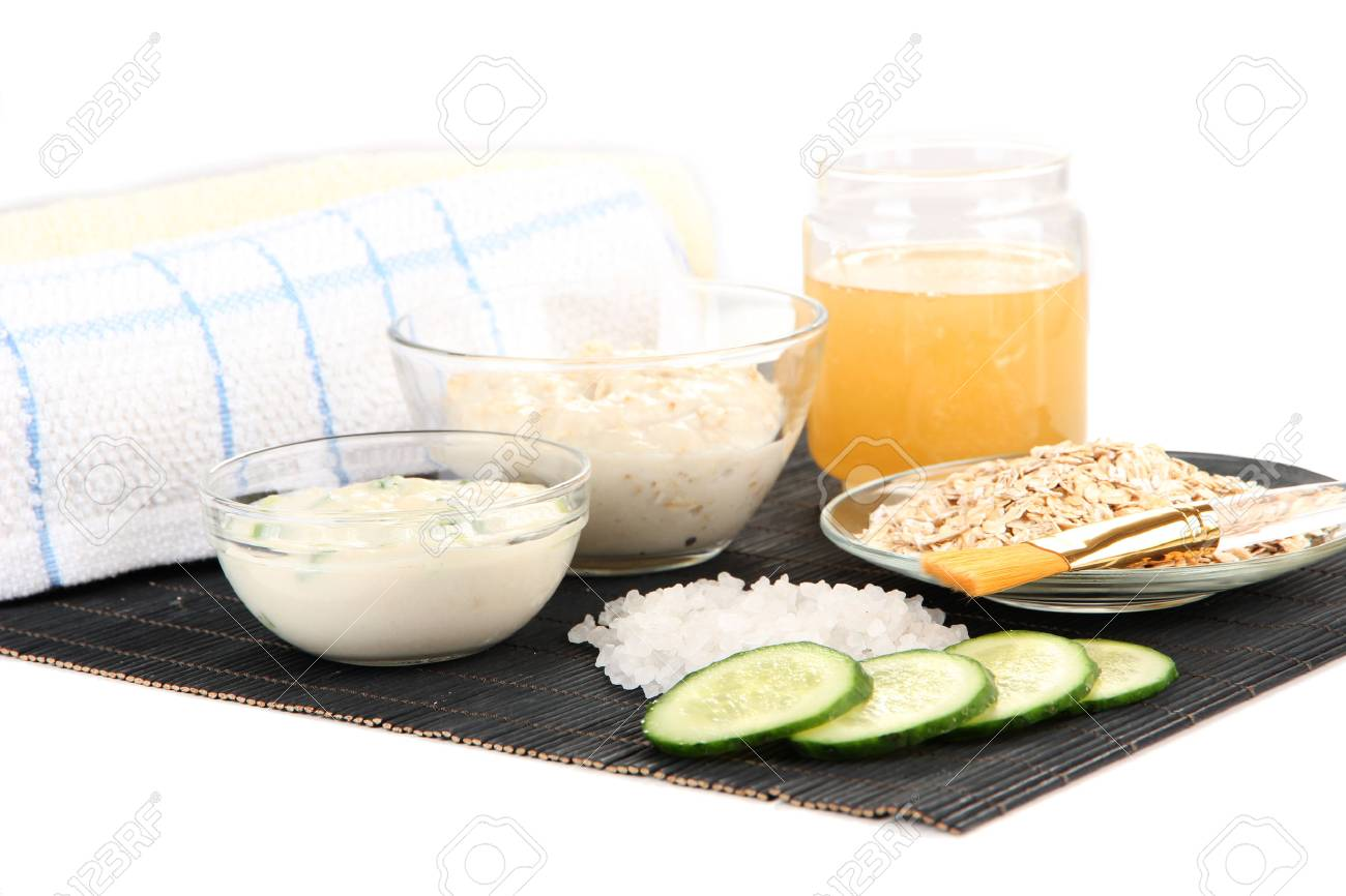 Homemade facial masks with natural ingredients, on bamboo mat, isolated on  white Stock Photo