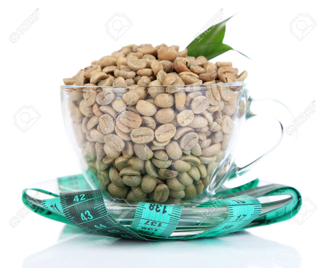 Raw Green Coffee Beans In Glass Cup And Measuring Tape Isolated