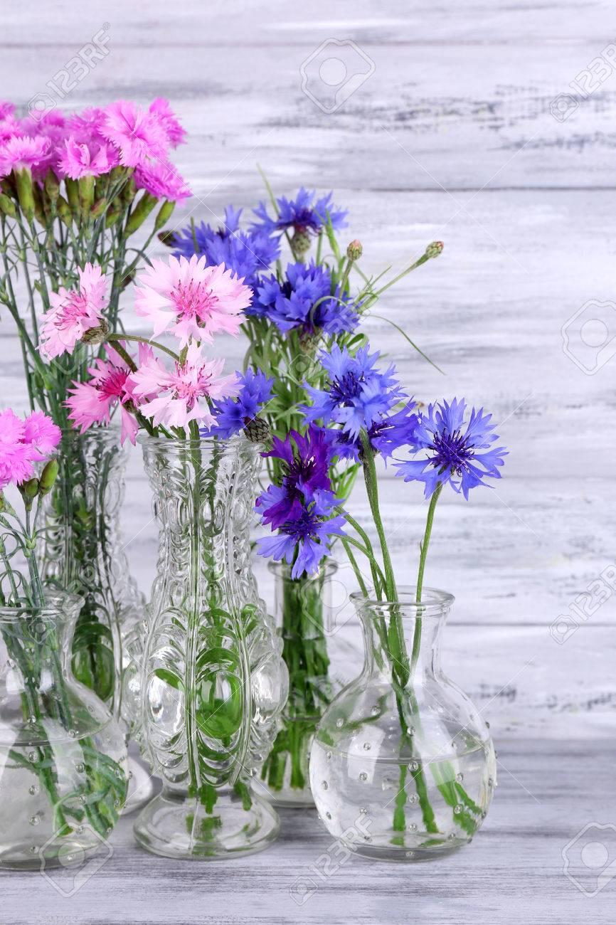 Beautiful summer flowers in vases on grey wooden background stock beautiful summer flowers in vases on grey wooden background stock photo 29674321 reviewsmspy