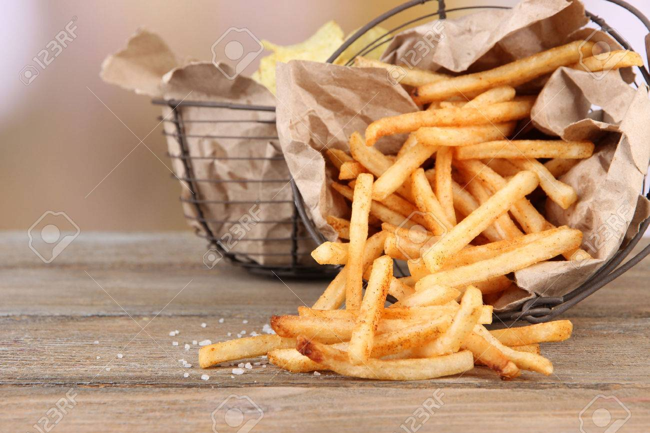 Image result for chips and fries on wooden table