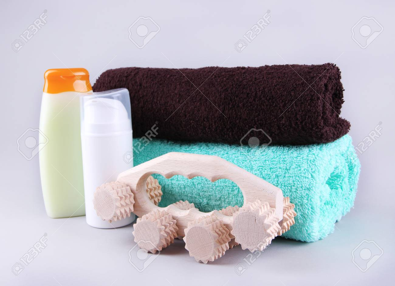 Wooden Roller Brush, Towels And Shower Kit On Grey Background Stock ...