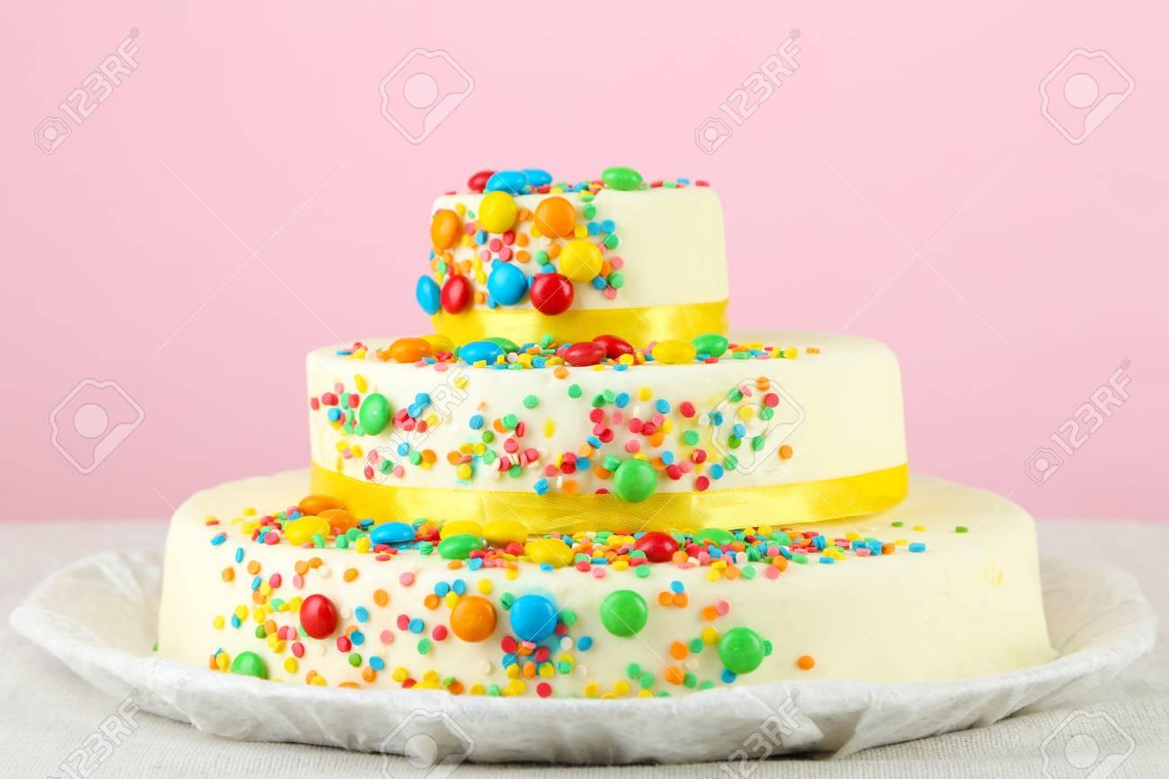 Beautiful Tasty Birthday Cake On Color Background Stock Photo