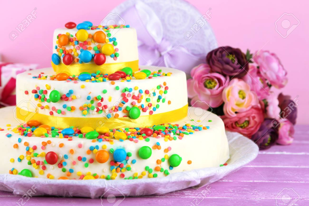 Beautiful Tasty Birthday Cake And Gifts On Color Background Stock Photo