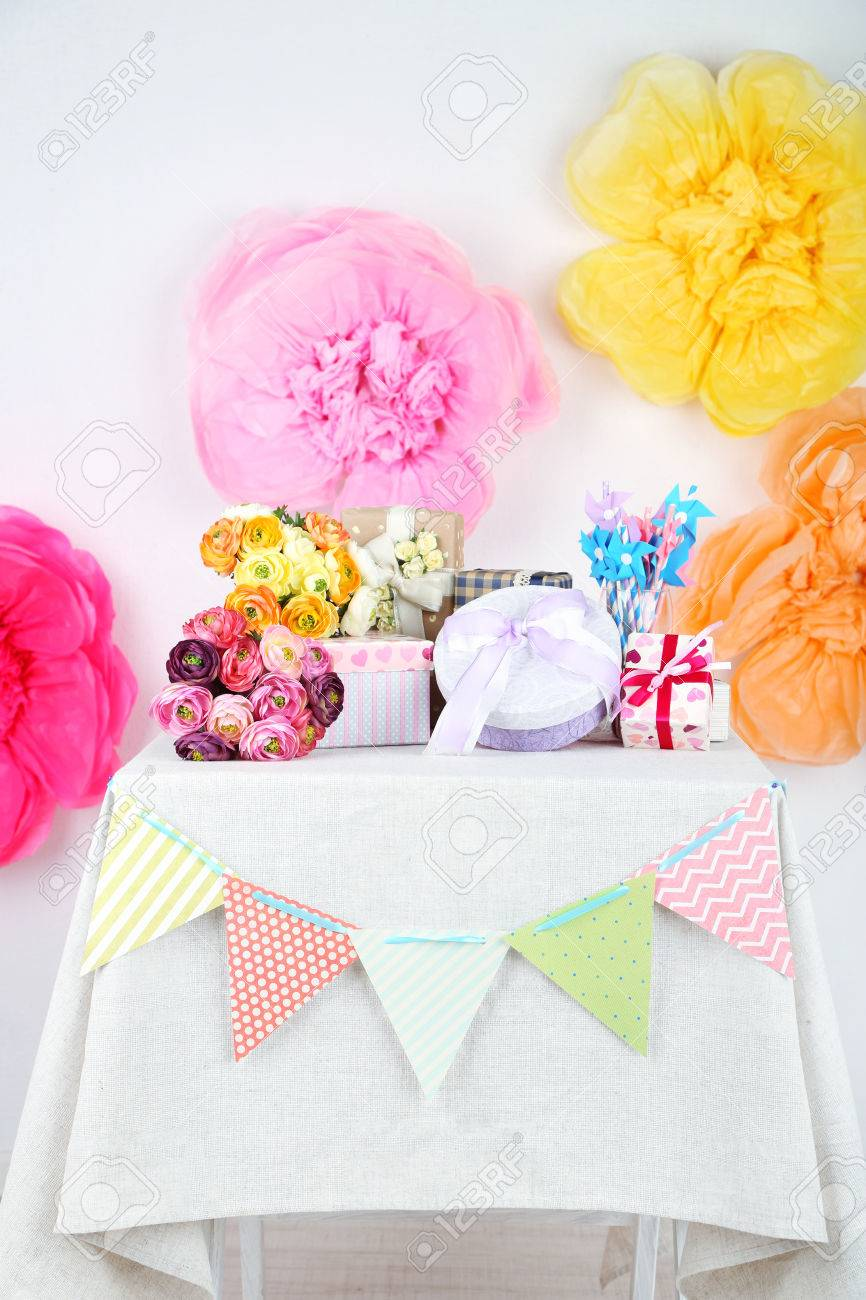Wedding Or Birthday Gifts On Decorated Table, On Bright Background ...