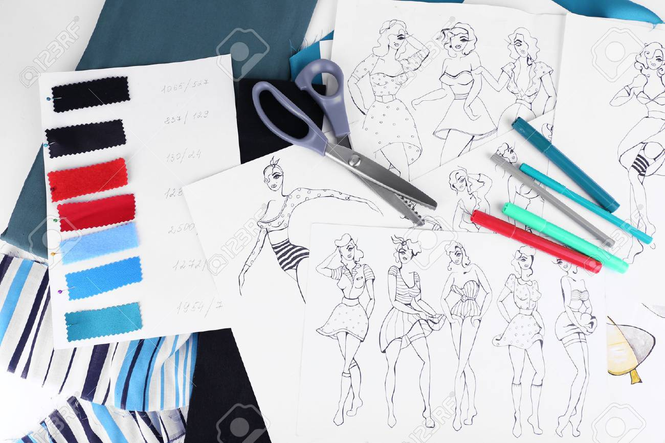 Sketches Of Clothes And Fabric Samples On Table Stock Photo   46899849