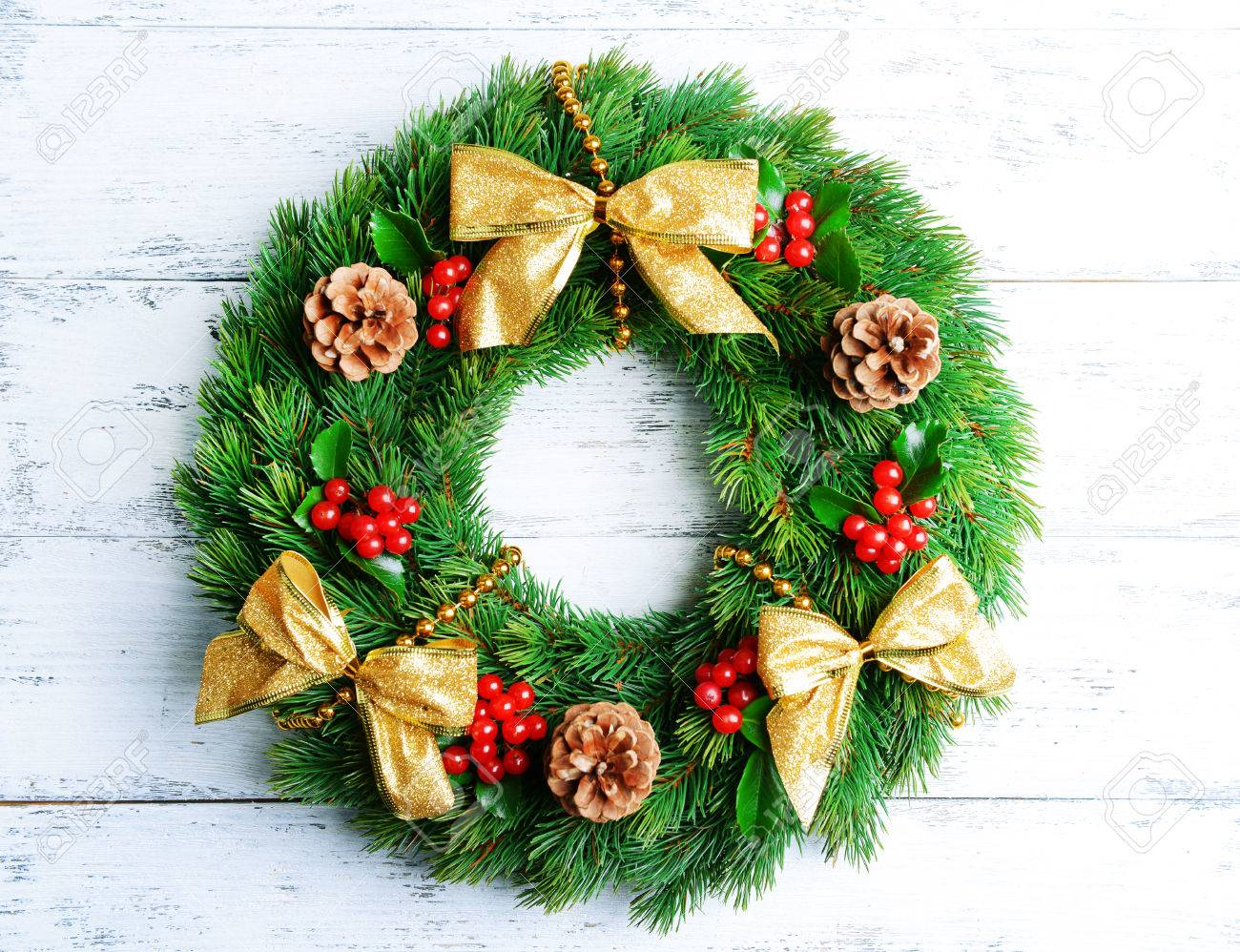 christmas decorative wreath with leafs of mistletoe on wooden background stock photo 50326331 - Mistletoe Christmas Decoration