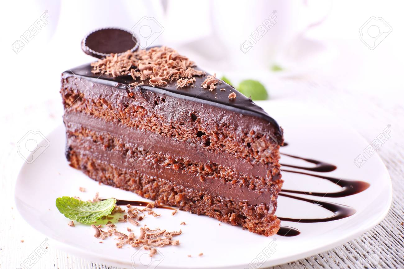 Delicious chocolate cake on plate on table on light background Stock Photo - 98074669  sc 1 st  123RF.com & Delicious Chocolate Cake On Plate On Table On Light Background Stock ...