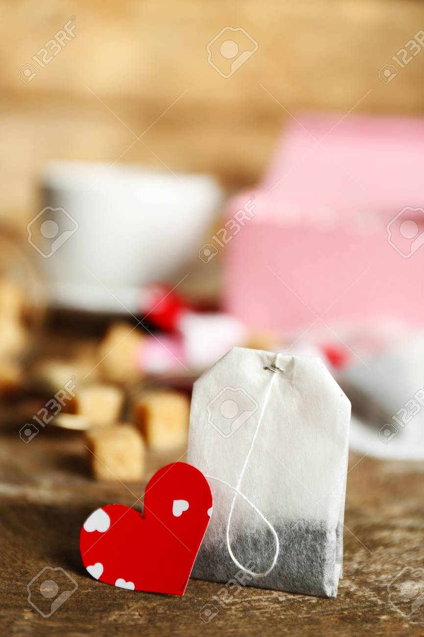 Heart Shaped Teabag Tags And Box On Wooden Background Stock Photo ...