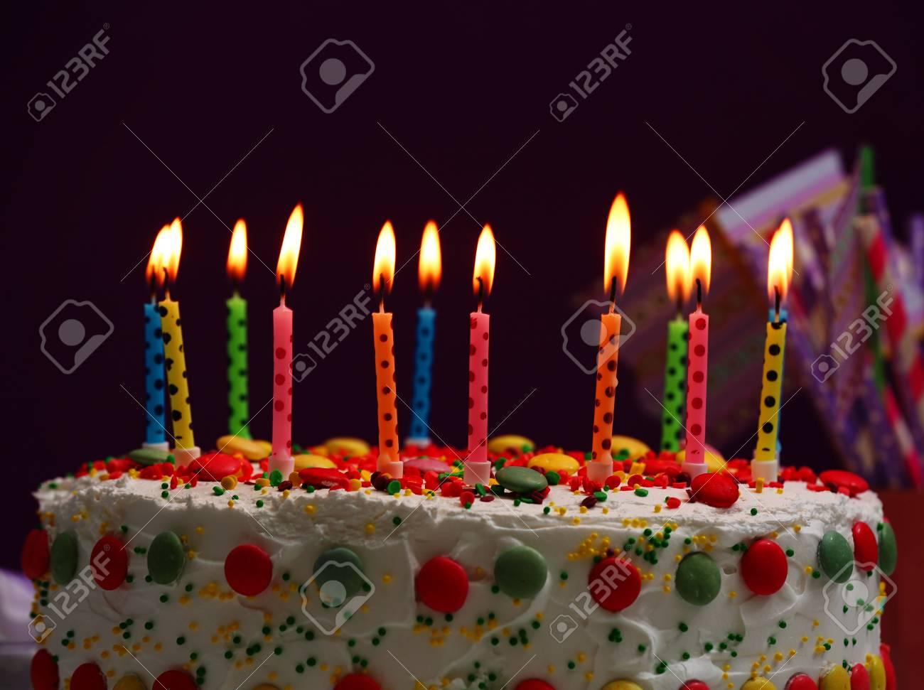 Birthday Cake With Candles On Purple Background Standard Bild