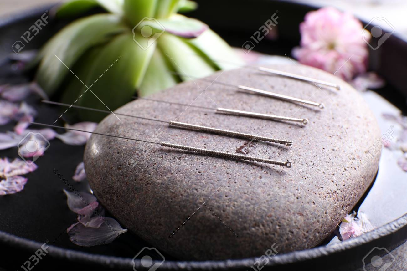 Acupuncture needles with spa stone on tray, closeup - 101224998